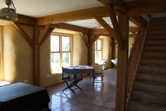 """Green BEES founders built this strawbale house with many """"deep green"""" features, such as super-insulated building envelope, passive solar design, composting toilets, graywater system, completely non-toxic finishes (lime plaster clay plaster, natural paints), living roofs, and more. Design by Sigi Koko."""