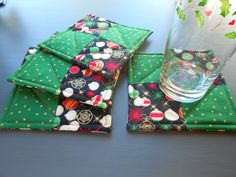 Quilted Coasters with Christmas black fabric with Ornaments of white, red and  metallic gold/ Set of Four by RubysQuiltShop on Etsy