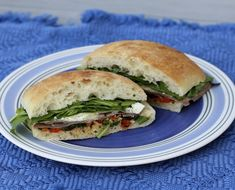 Make-ahead picnic sandwiches with roast beef, a red pepper tapenade, arugula, and feta.