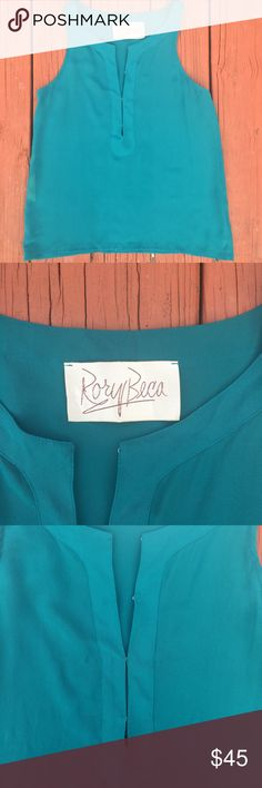 Rory Beca Silk Sleeveless Top Rory Becca Silk Sleeveless Top in gorgeous teal color. 100% Silk. Adjustable neckline. Excellent used condition. Rory Beca Tops Tank Tops