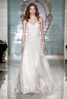 Brides.com: Reem Acra - Spring 2015. Strapless beaded re-embroidered lace and silk organza A-line wedding dress with a sweetheart neckline, Reem Acra