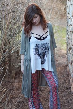 Boho Pattern Bell Bottoms - Livin' Freely These Boho Pattern Bell Bottoms are so comfy you won't want to take them off. They are extra long with a large flare, which is sure to take you back to the 70's! These pants are great paired with wedges are heels and a t-shirt or tank!