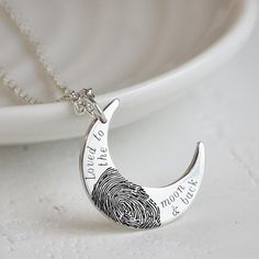 A gorgeous crescent moon pendant, capturing your own unique fingerprint in solid silver. Hand made to order and deep engraved with your own unique fingerprint, this beautiful pendant will make a wonderful gift for any mummy or grandmother. The front of the pendant features the wording