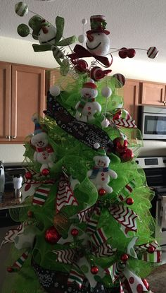 Tomato cage Christmas tree in a snowman theme.