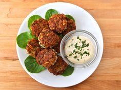 Seasoned fishcakes, known in Israel as ktzitzot dagim. Fried fish patties with pine nuts, breadcrumbs, & seasonings served with tahini sauce.