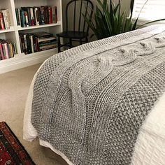 River of Dreams is a chunky, modern bed runner which features a giant cable and seed stitch border. This accent blanket adds a layer of coziness to your bed! The bold cable design adds texture and interest to any decor style. Cable Knitting Patterns, Dreams Beds, Bed Runner, Seed Stitch, Modern Crochet, Dream Bedroom, Crochet Designs, Decor Styles, Blanket