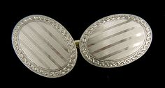 Among the most elegant cufflinks of the 1920s were the platinum and gold ovals created by Carrington & Company.  This beautiful pair features linearly engraved centers surrounded by spiralling, twisted-ribbon borders.  The platinum surfaces have a mesmerizing mirror-like finish.  Crafted in platinum and 14kt gold,  circa 1925.