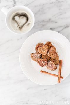 Heart French toast bites make the perfect Valentine's breakfast!  This easy Valentine's recipe makes adorable heart shaped toast bites with rich vanilla flavors and a cinnamon and sugar topping.