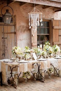 This French Inspired table is charming on sooo many levels! I love the lacy linnens, the flowers under the tables and the sweet chandelier.
