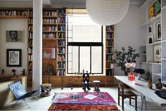 Floor to ceiling bookshelves and an open living space