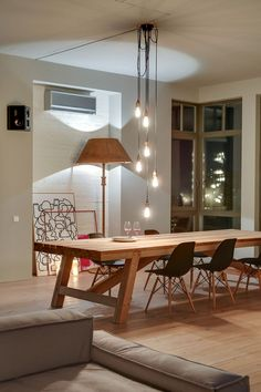 Stylish Loft in Kiev by Slava Balbek and Sasha Ivasiv 9 Spacious Modern Loft in Kiev Decorated with Stylish Details and Framed Cityscapes Küchen Design, House Design, Interior Design, Eclectic Design, Loft Design, Design Ideas, Dining Room Design, Dining Room Table, Wood Table