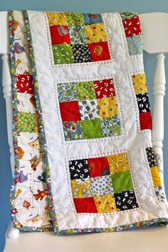 ABC 123 American Jane Baby Quilt by CoraHandmades  - very colourful - the black and white brings out the primary colours - it looks as if the back has some piecing, too.