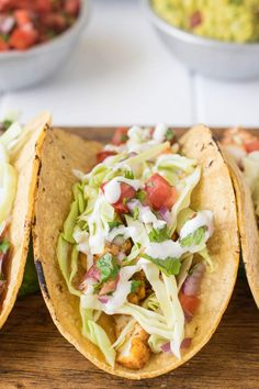 Baja style fish tacos recipe. Mexican spiced halibut pieces are sautéed, then nestled in corn tortillas with fresh shredded cabbage and homemade pico de gallo with lime crema
