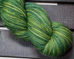 Cashmere, merino & nylon make for a perfect sock yarn! Indigo and osage orange give this yarn its pretty green, yellow, and blue hues.