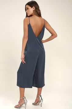 Lulus Exclusive! Let the Elisa Navy Blue Midi Jumpsuit lead the way to a luxe, laid-back look! Sleek, satiny fabric falls from skinny straps into a relaxed, triangle bodice and wide pant legs that end at a midi length.