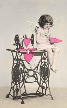 vintage sewing machine - valentine love with angel sitting on sewing machine.