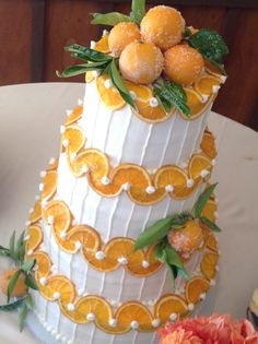 Buttercream cake with candied orange slices and decorated with sugared fruit.