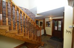 The Granary, Old Syndale - Stone flagged floor and a feature rustic brick exposed wall, wooden and glazed front entrance door, double central heating radiator and stairs to the first floor.