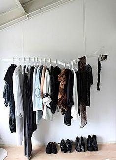 Branch clothes rail - cheap way of a clothes rail. paint a branch