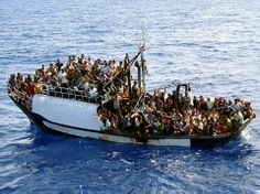 Sep 25, 2008 A photo released Thursday shows a fishing boat carrying 300 migrants in the Mediterranean before a French naval vessel intercepted them Wednesday. The French navy released the migrants to Italian authorities on the island of Lampedusa. (Agence France-Press — Getty Images)
