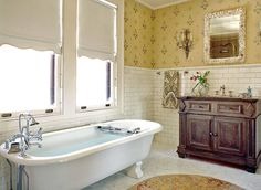 The master bath in A 1912 house designed by Addison Mizner sports a classic white subway tile wainscot. (Photo: Christian Giannelli)