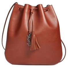 Saint Laurent 'Medium Jen' Calfskin Bucket Bag ($1,150) ❤ liked on Polyvore featuring bags, handbags, cuivre, yves saint laurent, hand bags, shopper handbags, red bag and red handbags