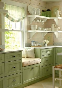 Love the green on cabinets.  For my kitchen, this green would be on walls.  My knotty pine cabinets would be refinished to a lighter stain (notice the walls in this pic), would like the light counter, white woodwork, and add a bit of subway tile.