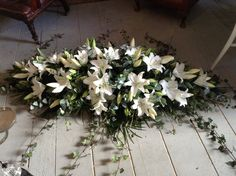 funeral flowers, white lily coffin spray, white lily casket spray www.thefloralartstudio.co.uk