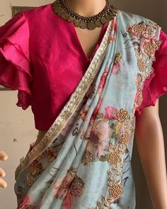 Beautiful floral organza saree in ice blue color with cut work embroidery all over it paired with hot pink multi layered ruffle sleeves blouse ! Can be mix and matched with our designer blouse collec Saree Blouse Neck Designs, Fancy Blouse Designs, Bridal Blouse Designs, Sleeves Designs For Dresses, Latest Blouse Designs, Cutwork Blouse Designs, New Saree Designs, Blouse Patterns, Modern Saree
