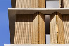 Image 28 of 37 from gallery of Vitacon Itaim Building / Studio - Marcio Kogan + Carolina Castroviejo. Photograph by Pedro Vannucchi Interior Design Magazine, Timber Screens, Timber Cladding, Cladding Ideas, Wooden Facade, Wooden Shutters, Building Facade, Building Design, Facade Design