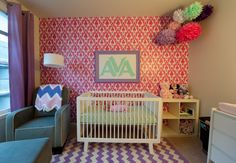 Bold pattern mixing with vibrant colors   #graphicwallpaper #pink #damask #chevronrug #pompoms #nursery #girl