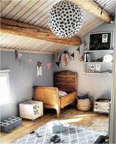 Wood beams on the top and bottom with an antique bed and a polka-dotted lantern? I'm in.  #estella #kids #decor