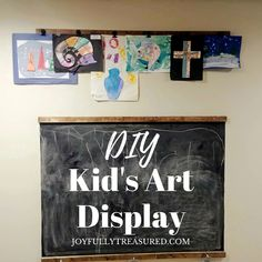 I needed a special (and tidier) way to showcase the kids art, and this kids art display wall in the playroom was the perfect solution! With just a few simple materials, this kids art wall display came together in about 30 minutes. #chalkboard #playroom #kidsart #farmhouse #budgetdecor #playarea #kidspace #homediy #basementplayroom Dollar Tree Decor, Playroom Storage, Black Spray Paint, Simple Pictures, Diy Chalkboard, Picture Hangers, Step By Step Painting, Art Wall Kids, Decorating On A Budget
