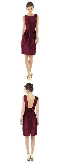A sophisticated high neck bridesmaid dress with an open back with a stunning bow detail.
