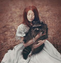 The unusual selection of animals in Plotnikova's striking works and their tender interactions with humans make her photography seem like digitally enhanced artwork. However, all of the animals are real and alive. Plotnikova's wild ideas materialized with the help of animal trainers as well as understanding and devoted professional models.