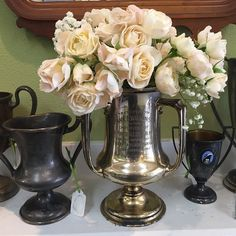 Antique trophy with spray roses  #wedding #vintagewedding #antiques #roses #WeddingRental