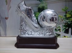 Ceramic Football Trophy, Soccer Trophy, Sports awards, Recognition awards, Trophy Cup. Sports trophy, soccer shoes is a nice item for soccer events One size available It is made of ceramic The item number is MD11204 Our email is sale1@hpceramics.com Web: http://www.hpceramics.com