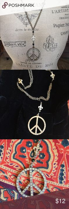 Rhinestone and Crystal, Silver Peace Sign Necklace Lovely rhinestone peace sign, black crystal and silver chain necklace. Rhinestone fleur de lis accents. Great layering piece. Amber Jewelry Necklaces