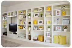 maybe across 18' of the one room in the basement only larger tv-----Ikea Billy Bookcases to built ins