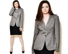 Vintage beautiful grey wool blazer made in Italy. The model on the pictures is size S/36 and 165 cm height. Please check measurements with your own to avoid problems with the size. Make sure you double the measurements where shown (*2):  Label size: M/38 Total lenght: 69 cm / 27 inches Sleeve lenght: 62 cm / 24.5 inches Shoulder to bottom: 66 cm / 23.5 inches Armpit to bottom: 40.5 cm / 16 inches Armpit to armpit: 47 cm *2 / 18.5 inches *2 Waist: 42 cm *2 &#...