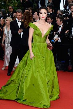 Chinese actress Zhang Yuqi. The dress is a great color, too bad that rain at Cannes left drops on it.