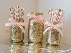 This listing will provide you with a set of 3 glass glitter mason jars decorated with gold glitter and light pink satin bows around the: