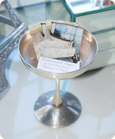 Chic way to display business cards! Use an antique silver champagne glass.