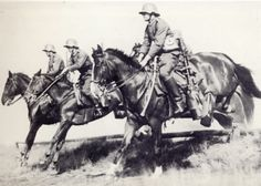 German cavalrymen training in the interwar years. Note the saber of the horseman nearest the camera. The men wear the M16 Stalhelm WW1 vintage steel helmet. The horse was very much present in the German army throughout WW2.