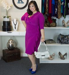 Plus size, real curve cutie Maxine has the bright idea here.  She paired the Plus Size Vivienne Dress in Magenta Maven by Kiyonna with some bold cobalt blue pumps and a white purse. What a fun, hot look to wear to an upcoming wedding or dinner date.  #plussize