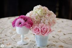 Clusters of pink flowers in white vases - milkglass