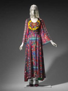 Thea Porter 1970 Woman's dress of chiffon printed with colorful Central Asian-inspired textile pattern, empire waist with embroidered yoke made from a vintage suzani (traditional Uzbek embroidered textile). Back zipper.