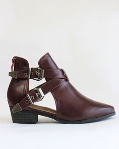 "Double buckles accentuate the open shaft of an urban bootie with Western undertones. Perfect for every season. Low stacked heel, zip closure at back. Approx. heel height: 1 1/2"" Approx. boot shaft hei"