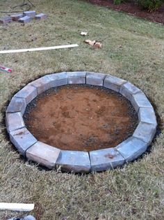 Low cost Fire Pit.  I want to line inside with cheaper cinder blocks and top it off with nicer pavers.