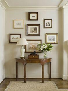 A sturdy little demi-lune and a balanced arrangement of frames - via Mrs Howard